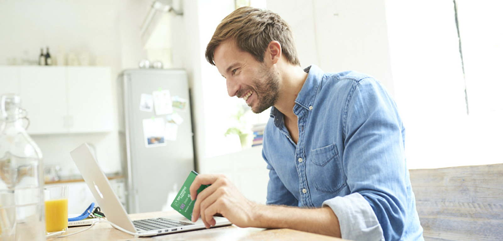Man paying with card on laptop